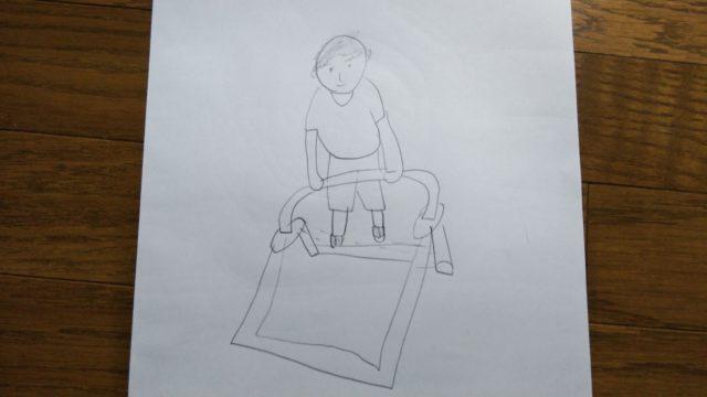 鉄棒をしている子供の絵