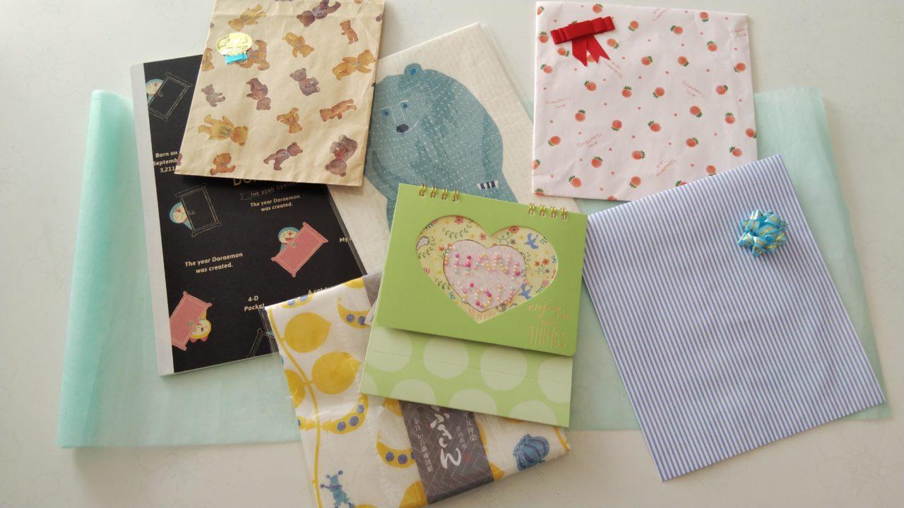 プレゼント袋とノートとふきんとメッセージ帳